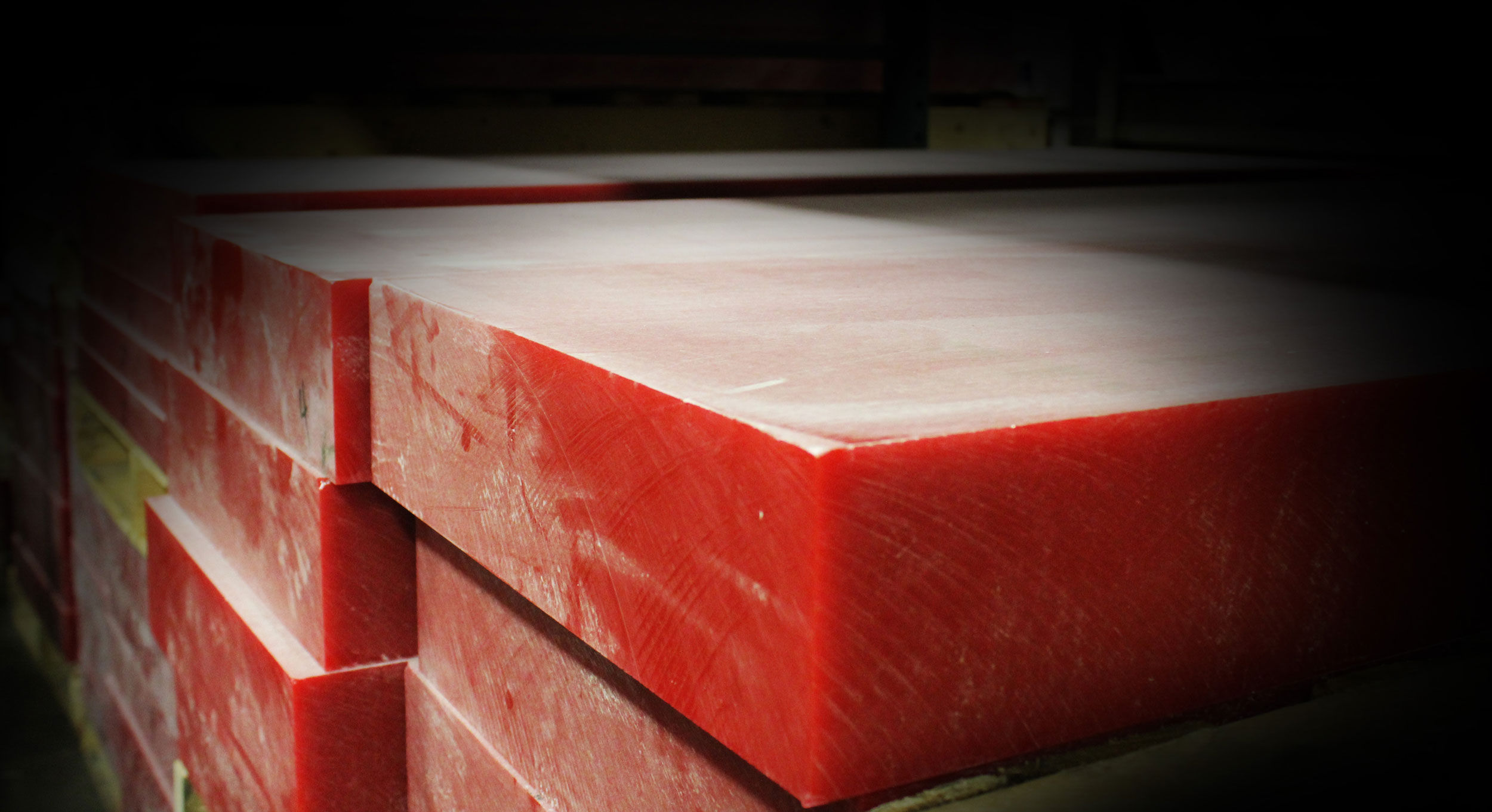 Stacked slabs of PP-1052 Red Board Tooling Boards