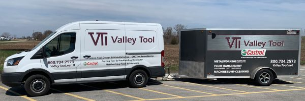 A Valley Tool van towing a trailer of sump cleaning equipment
